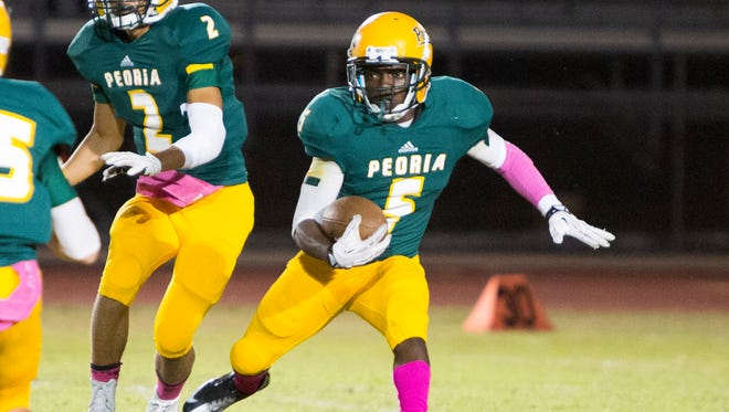 Peoria senior running back Akeem Rutledge cuts toward open field in a game against Phoenix Goldwater, Friday, October 17, 2014, in Peoria, Ariz.