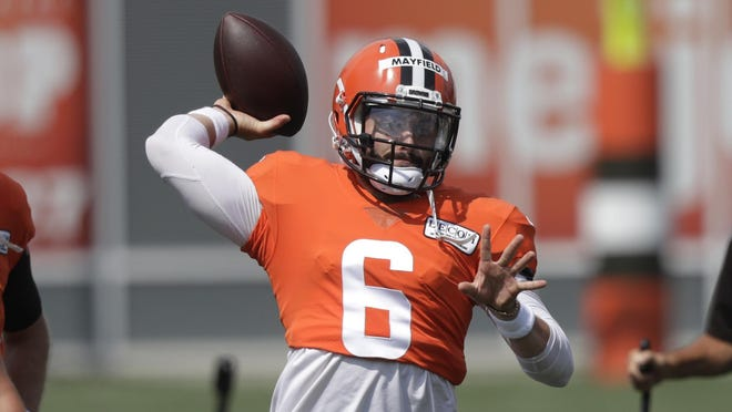 Cleveland Browns quarterback Baker Mayfield throws during practice at the team's training camp facility Aug. 27 in Berea, Ohio. Mayfield only had one more touchdown pass (22) than interceptions (21) last season.