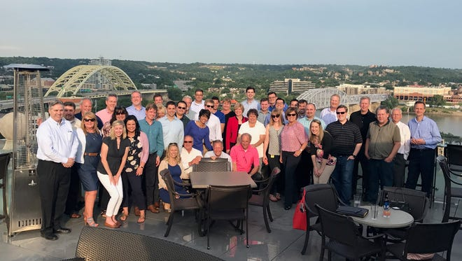 P.L. Marketing's leadership team gathers at the company's bi-annual meeting