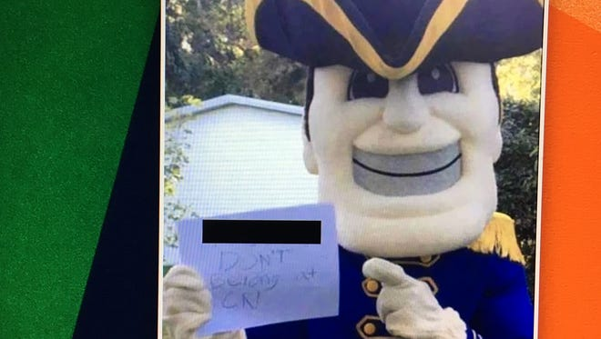 An image of what looks like the Caesar Rodney mascot holding a sign with a racial slur has been circulating in the district. The News Journal edited this version to cover the racial slur.