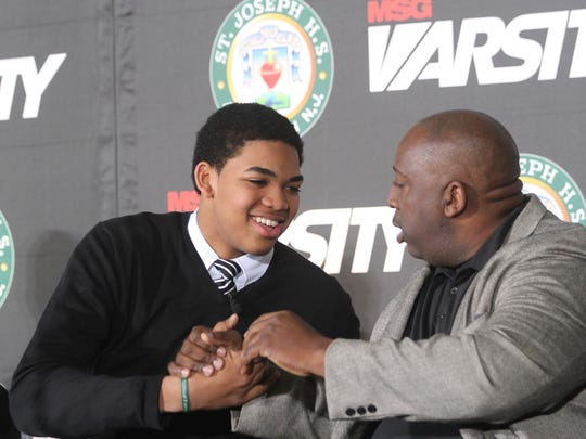 Karl-Anthony Towns with his dad in 2012 at St. Joseph-Metuchen High School.