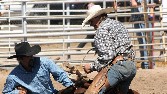 The Ranch Rodeo at the Southwestern New Mexico State Fair never fails to thrill spectators as ranch hands demonstrate their prowess on horseback and on the ground in penning, branding, or roping competitions as seen here on Saturday, October 7.