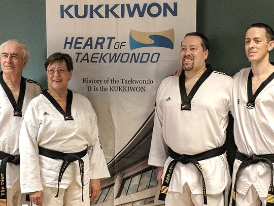 The Henkels (from left) Mark, Hilde, James and John recently became the first family to simultaneously achieve seventh degree black belt status according to the official world taekwondo governing body.