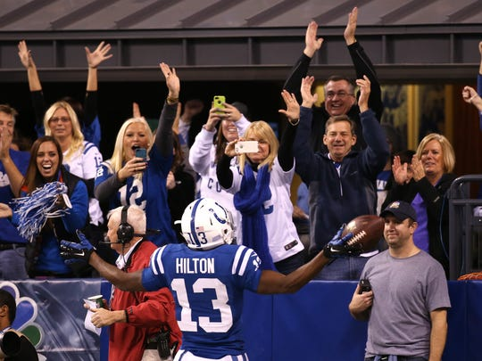 Colts fans react to T.Y. Hilton's first-quarter touchdown against the Chiefs. The Indianapolis Colts hosted the Kansas City Chiefs at Lucas Oil Stadium Saturday, Jan. 4, 2014.