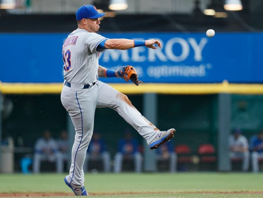 New York Mets shortstop Asdrubal Cabrera throws out Cincinnati Reds' Billy Hamilton at first in the first inning of a baseball game, Tuesday, Aug. 29, 2017, in Cincinnati. (AP Photo/John Minchillo)