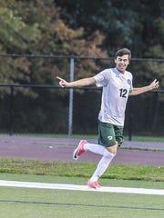Delbarton's Mark Forbes (12) celebrates the first goal