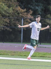 Delbarton's Mark Forbes (12) celebrates the first goal in the Morris County Tournament final.