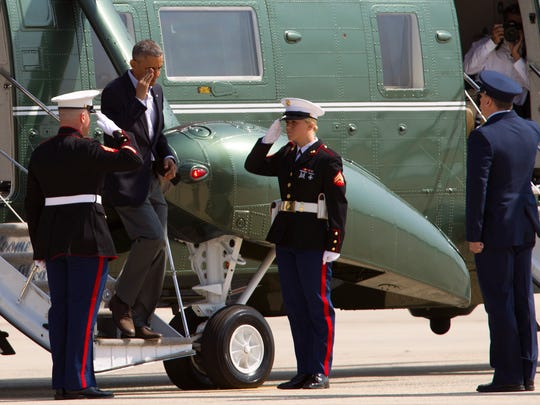 "President Barack Obama salutes as he steps off Marine One upon his arrival at Andrews Air Force Base in Md., Wednesday, April 22, 2015. Obama is celebrating Earth Day with a visit to the Everglades to talk about how global warming threatens the U.S. economy. He says rising sea levels are putting the ""economic engine for the South Florida tourism industry"" at risk. (AP Photo/Jose Luis Magana)"