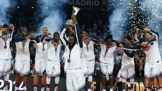 United States' James Harden lifts the trophy alongside the rest of the team players as they celebrate wining the final of the World Cup Basketball match between the United States and Serbia at the Palacio de los Deportes stadium in Madrid, Spain, Sunday, Sept. 14, 2014.