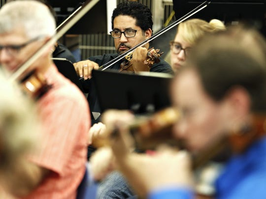 "Springfield Symphony Orchestra musicians perform during a rehearsal of Prokofiev's ""Romeo and Juliet"" at Evangel University in Springfield, Mo. on Sept. 13, 2016."
