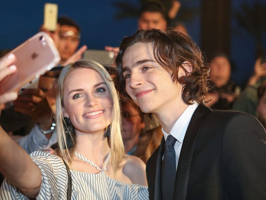 Timothee Chalamet interacts with fans during the Palm