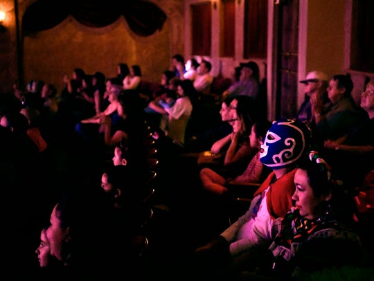 Audience members watch Fiesta at the Paramount April 21 at the Paramount Theatre,