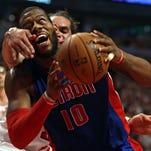 The Chicago Bulls' Joakim Noah fouls the Detroit Pistons' Greg Monroe.