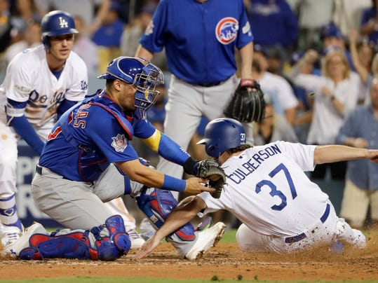 Cubs' Maddon ejected for arguing reviewed play at home plate