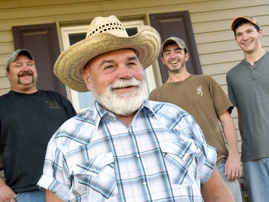 Since Wayne Hoffman, center, purchased his Dover farm in 1969, two more generations of his family have come to help with the land that provides cattle, corn, soybean and wheat: his son Joshua, left, and grandsons Weston, 19, second from left, and Wyatt, 16.