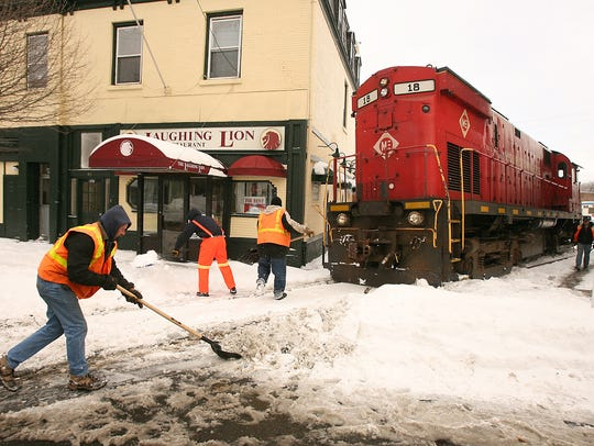 Snow plowed onto railroad tracks in Dover apparently