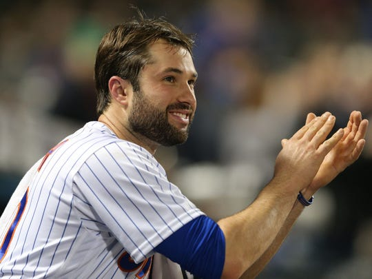 Mets second baseman Neil Walker (20) applauds from the dugout after New York Mets relief pitcher Fernando Salas (not pictured) hits a single against the Milwaukee Brewers during the sixth inning at Citi Field.