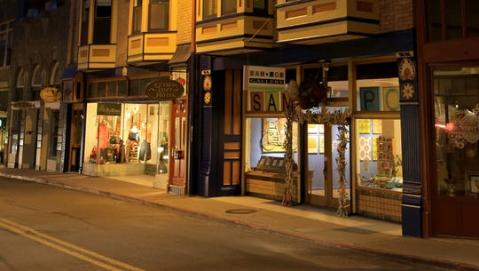 The SAM•POE Gallery and other Old Town businesses glow