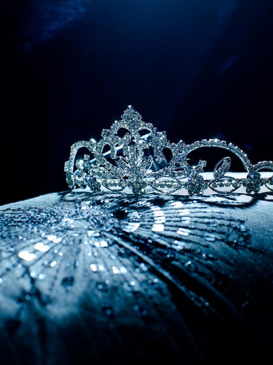 Moody photo of a tiara presented on a pillow