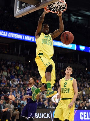 March 18, 2016; Spokane , WA, USA; Oregon Ducks forward Elgin Cook (23) dunks to score a basket against Holy Cross Crusaders during the second half in the first round of the 2016 NCAA Tournament at Spokane Veterans Memorial Arena. Mandatory Credit: Kyle Terada-USA TODAY Sports