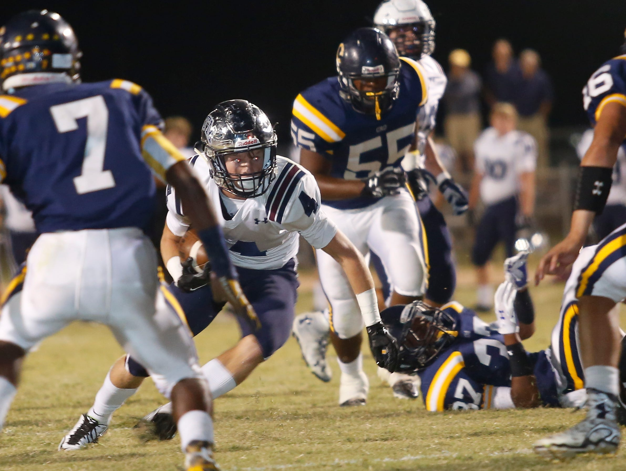 Trevor Begue finds a hole in the Carencro defense to score giving STM a 14-0 after a successful point after on Friday night in the Cro Dome. John Rowland/Special to the Advertiser