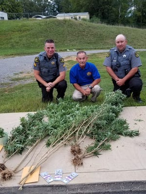 Stewart County Sheriff Frankie Gray, center, poses for a photo with Sgt. Ryan Goldsmith, left, and Deputy Shane Keatts, who confiscated marijuana plants growing at a Big Rock residence and charged the resident.