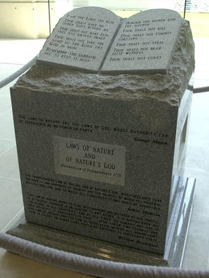 The Ten Commandments monument Roy Moore installed at the Heflin-Torbert Judicial Building, shown here in 2001.