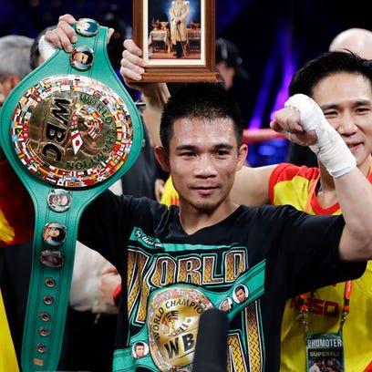 Sor Rungvisai retains super flyweight title with majority decision over Estrada