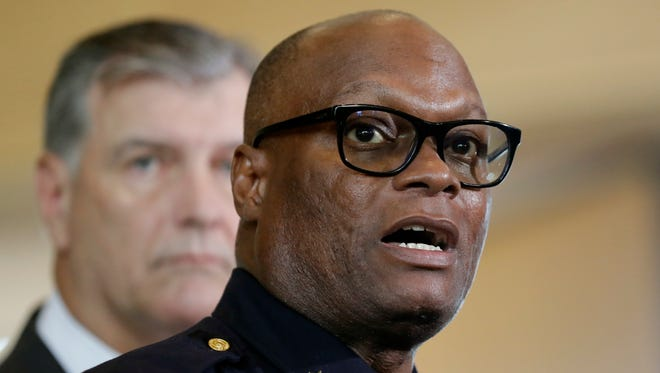 Dallas police chief David Brown, front, and Dallas Mayor Mike Rawlings talk with the media during a news conference Friday in Dallas after snipers opened fire on police officers in the heart of the city Thursday night.