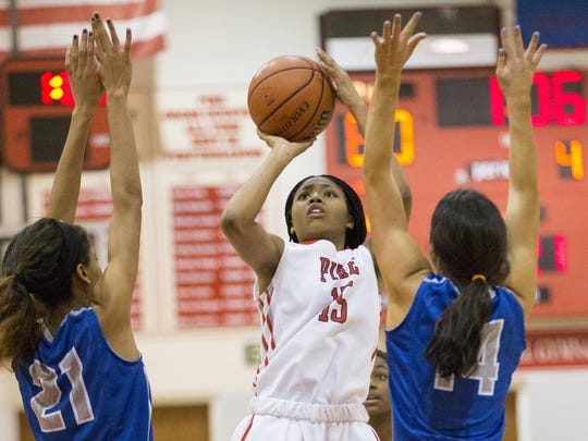 Angel Baker (center) averages 18.4 points a game for Pike.