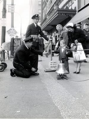 The Indianapolis Fire Dept. collect dimes for the Mile O Dimes for  Clothe a Child in front of L.S. Ayres in the 1950s. The program was started by the Indianapolis Times newspaper.