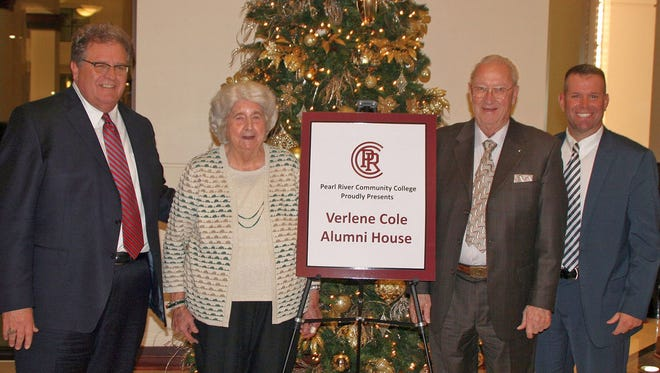The Pearl River Community College Development Foundation and Alumni Association surprised Verlene Cole of Oak Grove with the decision to name the Alumni House in her honor. Pictured with her at a Dec. 7 dinner on campus are, from left, Foundation director Ernie Lovell, Foundation chairman Francis Herrin and Adam Breerwood, PRCC president.