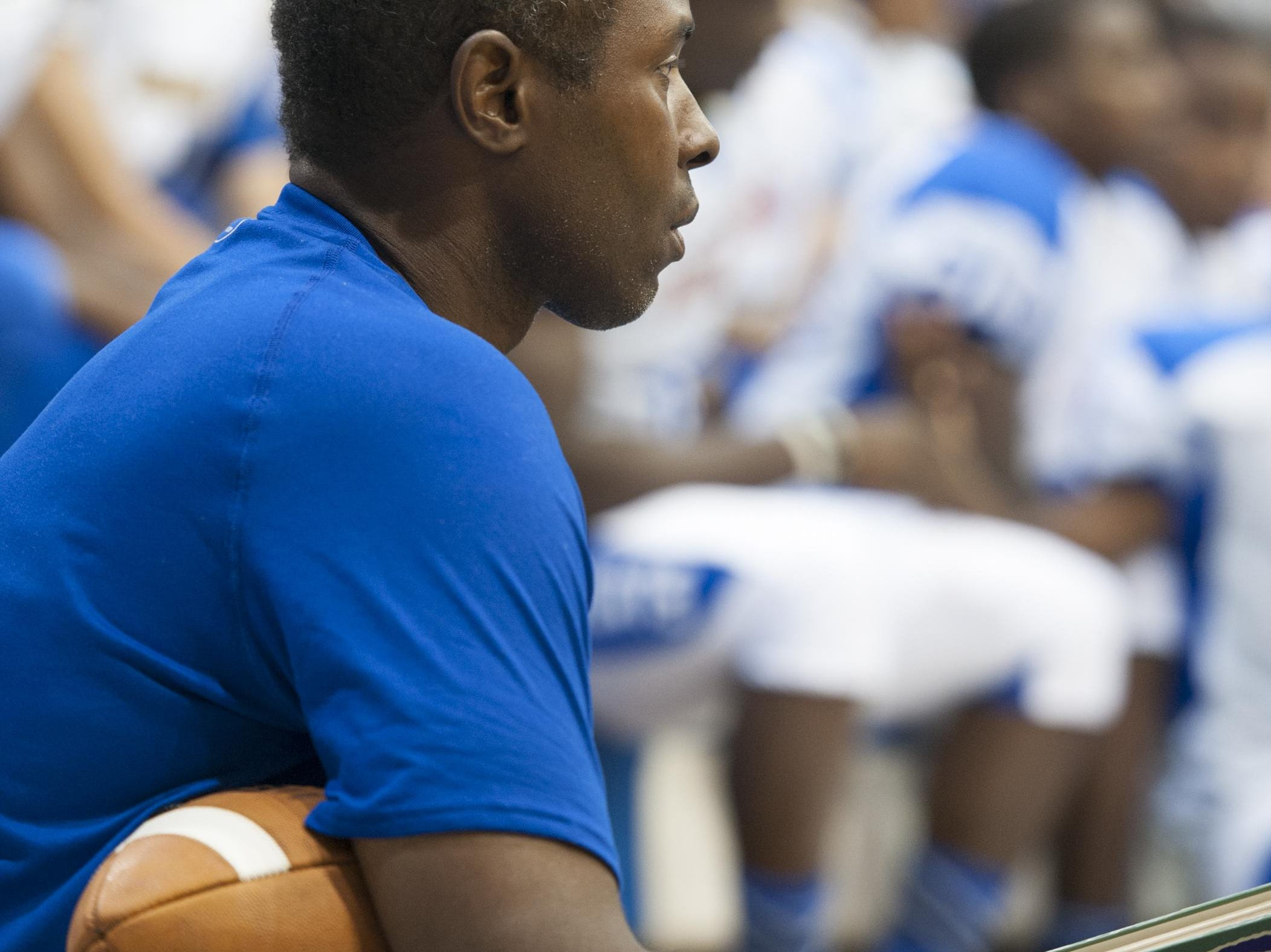 Head coach Charlie Ward waits for the team photo during football team picture day at Booker T Washington High School in Pensacola, FL on Friday, August 5, 2016.