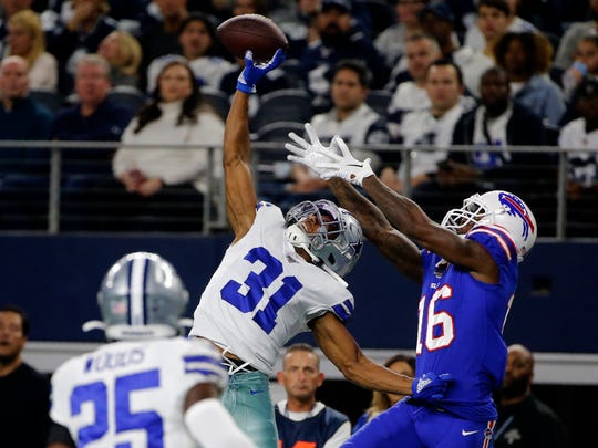 FILE - In this Nov. 28, 2019, file photo, Dallas Cowboys cornerback Byron Jones (31) breaks up a pass intended for Buffalo Bills wide receiver Robert Foster (16) in the first half of an NFL football game in Arlington, Texas. After months of hoarding resources for rebuilding, the Miami Dolphins finally started spending Monday, March 16, 2020, when they sealed deals with four likely starters in the early hours of free agent negotiations. Miami made Jones the NFL's highest-paid cornerback, surpassing his new teammate, Xavien Howard. (AP Photo/Michael Ainsworth, File)