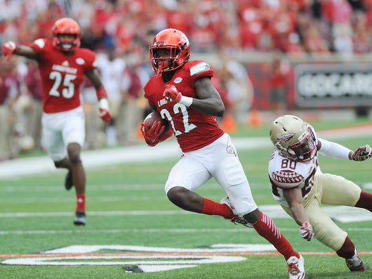 Louisville's Chucky Williams (22) runs after an interception against Florida State on Saturday at Papa John's Cardinal Stadium. UofL won 63-20. (Photo by David Lee Hartlage, Special to The Courier-Journal) Sept.17, 2016