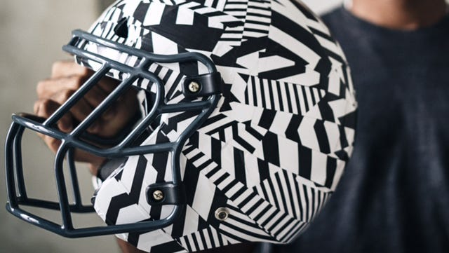 A new football helmet under development by the University of Washington and start-up Vicis that has impact-absorbing material.
