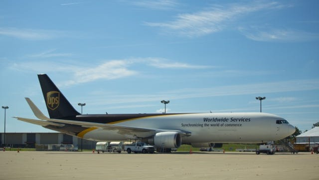 A UPS cargo carrier sits on the tarmac at Capital Region International Airport, which serves as the hub for the package delivery service's Michigan Air Operations.