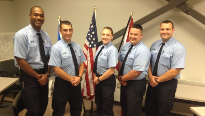 From left, Rochester firefighters Justin Walker, Mike Oliveri, Devon Monin and brothers Sal Mitrano and John Mitrano. All five graduate from the fire academy Friday and will follow their fathers into the department.