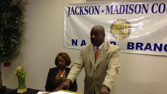 Harrell Carter, president of the Jackson-Madison County Branch of the NAACP, speaks during a news conference.