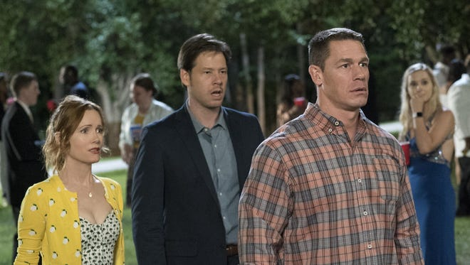 """Leslie Mann, left, Ike Barinholtz and John Cena play protective parents in the comedy """"Blockers."""""""