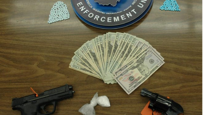 A METRICH raid Thursday morning netted guns, cash and drugs including 188 fake Oxycodone pills. One man was arrested.