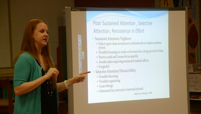 Alexandria pediatric psychologist Lauren Stokes gives a workshop for St. Frances Cabrini Elementary School faculty and staff with information about ADHD and how to recognize it in the classroom on Wednesday.