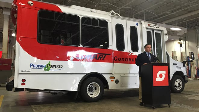 Todd Mouw, Vice President of sales and marketing for ROUSH CleanTech in Livonia, speaks at SMART's Macomb Terminal in Clinton Township on May 21, 2015 during a ribbon cutting for 61 new propane autogas fuel system paratransit Connector buses.