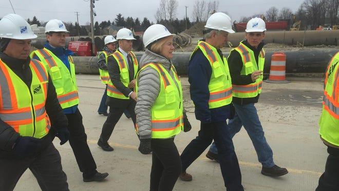 Public Works Commissioner Candice Miller, Gov. Rick Snyder and County Executive Mark Hackel visit the Fraser sewer line sinkhole in Fraser, Sunday, Jan. 8, 2017.