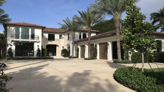 A deed recorded Thursday documented the $33.2 million sale of this recently completed  house developed on speculation at 446 N. Lake Way in Palm Beach. The house was built by Mark Pulte of Mark Timothy Inc.