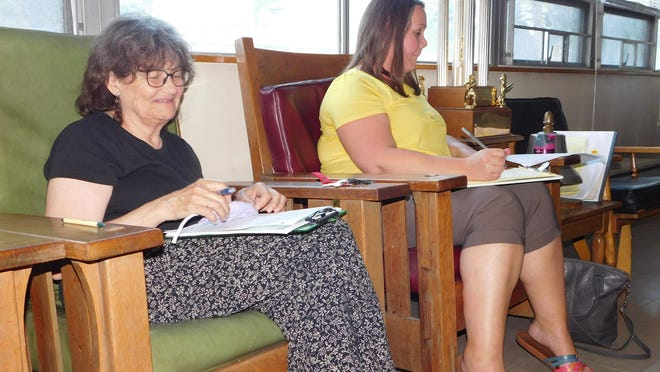 Mohawk Village Clerk-Treasurer Judy Bray, left, who is retiring from that position after 33 years, is shown during a village board meeting Monday. At right is Joni LaBarge, who will be taking over as the new clerk-treasurer.