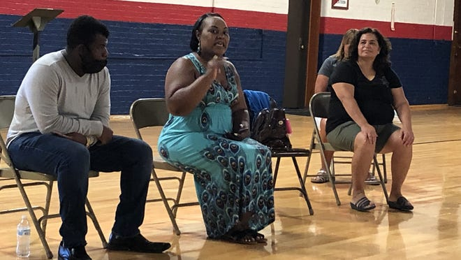 Karen Iglesia, center, talks during an event in Geneva bringing together law enforcement, youth and others to improve communication and race relations. To the right is Donna Schaertl, Back the Blue coordinator in Ontario County, who helped organize the event. At left is Jamel Johnson.