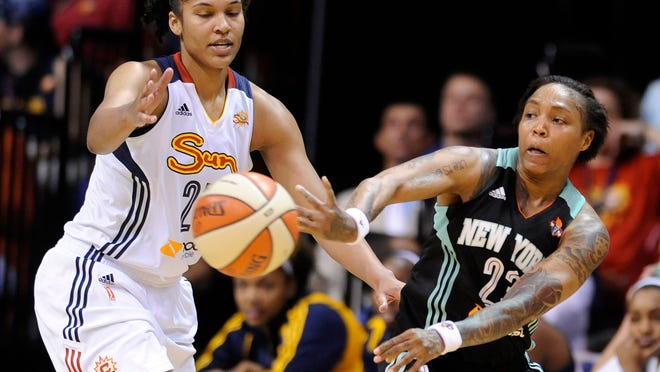 New York Liberty guard Cappie Pondexter (right) passes while being defended by Connecticut Sun forward Alyssa Thomas during the first half Sunday.