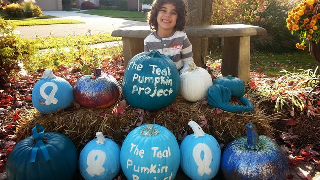 Elias Habib, 4, of Rochester painted pumpkins teal as part of a food-allergy awareness campaign called the Teal Pumpkin Project. His family will display the pumpkin and pass out nonfood treats this Halloween to children like Elias, who has a life-threatening peanut allergy.