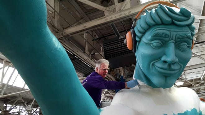 "At the Parade Company's studio earlier this month, volunteer Ron Dershem, 65, of Davisburg paints a replica of ""The Spirit of Detroit"" for <137>the ""Plugging in the World""<137> a float sponsored by Lear, a new addition to America's Thanksgiving Parade. <137>Volunteer Ron Dershem, 65, of Davisburg paints ""The Spirit of Detroit"" as a part of the ""Plugging in the World"" float sponsored by Lear Corporation, a new edition to America's Thanksgiving Parade at the Parade Company' s studio in Detroit on Nov. 11, 2014.<137><252><137>Olympic Gold Medalists Meryl Davis and Charlie White will be the grand marshals for America's Thanksgiving Parade on Thursday, Nov. 27, 2014.<252><137>"